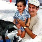 JD and Bobby play with a kid at the Honolulu Zoo, December 2000.
