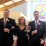 Joe, left, and Dan Zimmermann escort their mother, Chris, during Sarah's wedding, Aug.23, 2013.