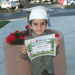 Bobby gets his pre-school graduation certificate, June 5, 2004.