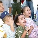 Bobby and other kids react to a clown outside Whole Foods in San Ramon in September 2002.