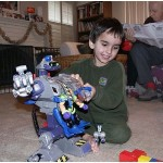Bobby with his new robot on Christmas Day 2002, with Grandpa Schrader in the background.