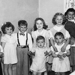 A convention of cousins in the spring of 1950. From right to left, Johnny Lasica, Dolores Wojcik holding little brother Walter Jr., Carole Wojcik with Jessica Stagg, Susanne and Robert Krzynowski, Eddie (a neighbor), Kathy Lasica and Bobby Lasica. (Emil Lasica is hidden behind dresser.)