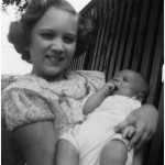 Kathy Lasica holds 3-month-old brother Joe at Staggs Farm in the fall of 1955.
