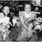 "Ken Sporn cradles his sister Gale next to cousin Kathy Lasica at Christmas 1955. Years later Kathy recalled, ""I was very much afraid of that doll,"" a knockoff of 1950s TV ventriloquist Paul Winchell's dummy Jerry Mahoney."