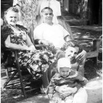 Luke and wife Mary Delenta with Lil Lasica holding son Joe and Walter and Jean Wojcick looking on, at the Wojcicks' lakeside vacation retreat at Greenwood Lake, spring 1956.