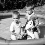 George and Joe in their backyard pool.