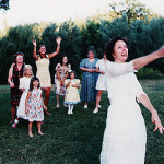 Mary tosses the bouquet at her wedding.