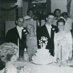 Ernie and Lorraine Sporn with their wedding cake and guests at their reception in 1947. Email Lasica and Mary Schepper Sporn are at the left.