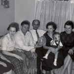 From left, Mary Schepper Sporn, Gladys Sporn DeVries, Dan DeVries, Email Lasica, Lil Sporn Lasica holding son Joseph on his 1st birthday in 1956, Midge Sporn and a family friend.