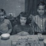 George and Joe Lasica with their cousin Gale Sporn playing a board game at the Sporns' house in Wallington, NJ, around 1961.