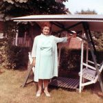 Katherine Delenta in her back yard in East Paterson, NJ, probably in the 1960s, next to the wooden canopy swing or glider that the grandkids used to love rocking back and forth.