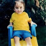 A cherubic-looking Bobby on his slide in our back yard.